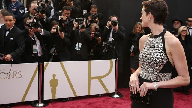 Anne Hathaway arrives at the Oscars on Sunday, March 2, 2014, at the Dolby Theatre in Los Angeles.  (Photo by Matt Sayles/Invision/AP)