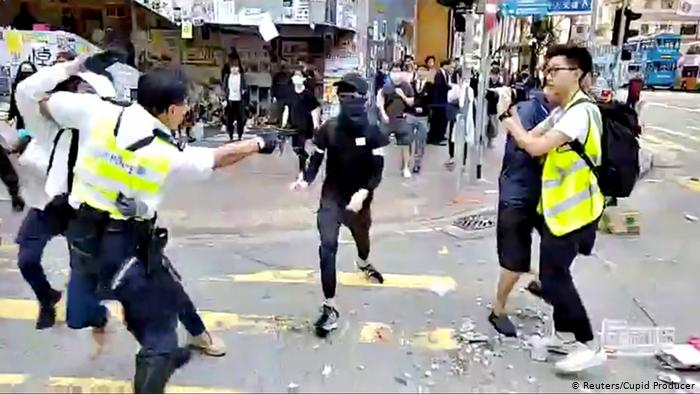 Video shows HK police shooting unarmed protester