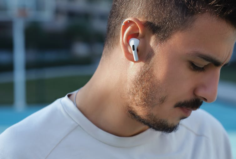 Earphones make you look cool, and produce excessive earwax