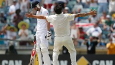 England's James Anderson, left, looks down as Australia's Mitchell Johnson celebrates Australia's victory over England in their Ashes cricket test match Tuesday, Dec. 17, 2013, in Perth, Australia. Australia won the match by 150 runs and take an unbeatable 3-0 lead in the five game series.